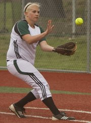 Free State first baseman Whitney Rothwell fields a grounder against Shawnee Mission East on Wednesday, May 1, 2013, at FSHS.