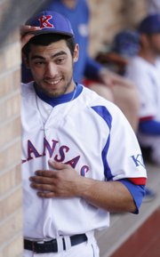 Kansas University first baseman Alex DeLeon watches from the dugout during the Jayhawks' 8-0 victory against Baker University Wednesday at KU.