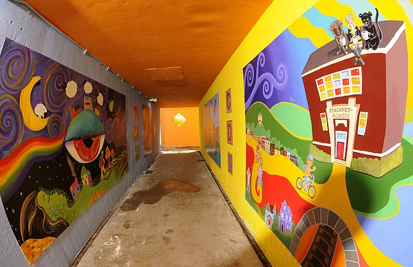 Bright-colored mural panels now line both walls the length of the Pinckney Elementary School tunnel beneath Sixth Street.