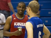 Former Kansas player Jeff Hawkins, left, speaks with Bill Self Fantasy Camp participant Jeff Nordstrom, Portland, Ore., following the game in which former Jayhawk players joined in and played with fantasy campers on Thursday, May 2, 2013, at Allen Fieldhouse.