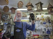 Ted Freeman will have his crafted birdhouses available at Sunday's Art in the Park. Both his large and miniature houses are made from recycled and polished tin and wood.