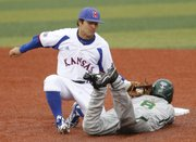 Kansas University infielder Justin Protacio (20) puts the tag on Baylor runner Lawton Langford (8), foiling a steal attempt during in the Jayhawks' first game of a three-game weekend series against the Bears, Friday, May 3, 2013, at Hoglund Ballpark. KU won, 3-2.