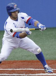 Kansas University's Ka'iana Eldredge lays down a bunt to drive in a run in the Jayhawks' three-run fifth inning against Baylor, Friday, May 3, 2013, at Hoglund Ballpark. KU won, 3-2.