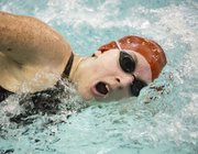 Lawrence High freshman Taylor Schoepf competes in the girls 200-yard freestyle event at the Sunflower League Preliminaries, held Friday in Olathe.