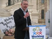 House Minority Leader Paul Davis, D-Lawrence, speaks at the Working Kansas Alliance rally Saturday at the Statehouse.