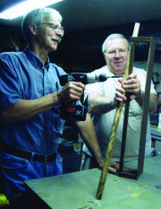 Jack Riegle, Theatre Lawrence's longtime technical director and one of two members of its Volunteer Hall of Fame, and Ron Chinn work in the scene shop at Theatre Lawrence, 1501 New Hampshire St.