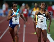 Kansas' Paris Daniels, left, edges out Texas' Courtney Okolo to win the women's 4X400-meter relay during the Big 12 Conference Outdoors on Sunday, May 5, 2013, in Waco, Texas.