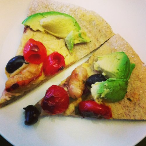 Avocado, pepper and olive pizza with hummus instead of sauce on a dough made with local CSA wheat.