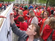 """Lines form Wednesday outside the Statehouse to sign a banner asking Gov. Sam Brownback to """"carve out"""" long-term care for those with disabilities from KanCare."""