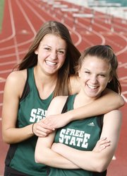 Free State runners Bailey Sullivan, left, and Molly McCord, both juniors, have been running together year-round since they were freshmen.