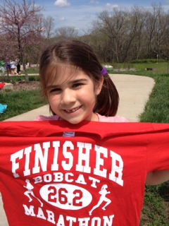 Juliet proudly displays her finishing t-shirt.