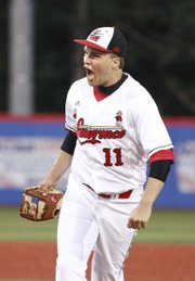 Lawrence High starter Brandon Bell celebrates a strikeout to end the top of the seventh against Free State on Thursday, May 9, 2013 at Hoglund Ballpark. Nick Krug/Journal-World Photo