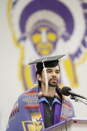 Haskell Indian Nations University student Tyler Levier, the American Indian College Fund Student of the Year at Haskell, addresses his classmates Friday morning during Haskell's 2013 spring commencement in Coffin Sports Complex.