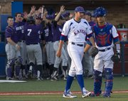 Kansas pitcher Thomas Taylor, center, walks past teammate Ka'iana Eldredge on his way back to the mound as Kansas State's Ross Kivett (7) is congratulated by teammates as he walks into the dugout after scoring during Kansas' game against Kansas State Friday at Hoglund Ballpark.
