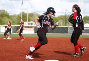 Lawrence High's Brook Sumonja rounds third on her way home to score during the fourth inning against Shawnee Mission North on Friday, May 10, 2013, at Lawrence High.