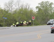 Search teams on horseback search along Highway 68, near the Eisenhower Drive intersection, Friday afternoon in Ottawa. Crews on horseback were seen all Friday combing Highway 68, fanning out east and west from Georgia Road, where three bodies were discovered Monday. Police continue to search for missing 18-month-old Lana-Leigh Bailey.
