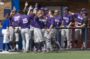 Kansas State players celebrate a run scored during the final game of Kansas' three game home series against Kansas State Sunday at Hoglund Ballpark. The Wildcats swept the series.