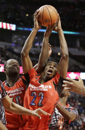 McDonald's East All-American's Andrew Wiggins (22) and Julius Randle (30) battle for a rebound during the second half of the McDonald's All-American Boys basketball game in Chicago on April 3, 2013.