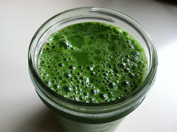Green juice featuring CSA spinach and carrots.