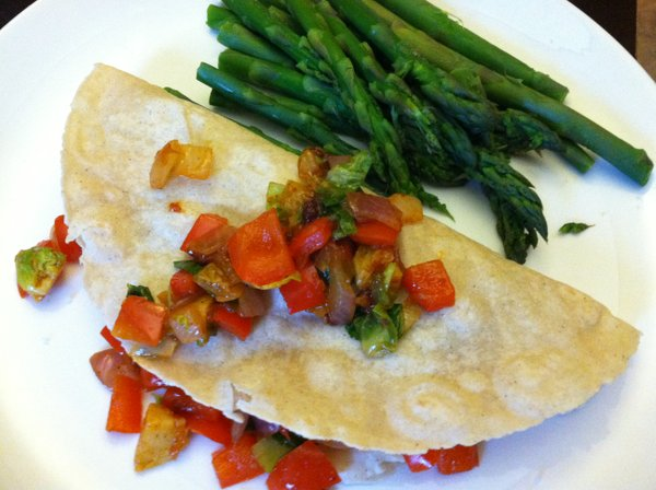 Egg burrito with steamed asparagus.