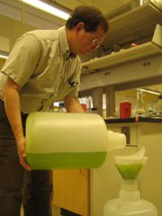 Val Smith, Professor Ecosystem Ecology, harvests algae in a lab in Haworth Hall on the KU Campus.