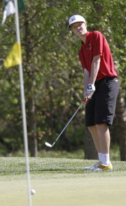 Lawrence High golfer Brett Van Blaricum hits a pitch shot onto a green Monday, May 13, 2013, at the 6A regional golf tournament at Alvamar Golf Course.
