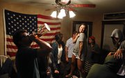 Students party at a Tennessee Street home before heading out to the bars on Stop Day on May 10.