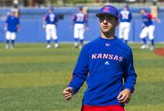 Kansas University baseball manager Jonathan Rosa walks the field during a pre-game workout Sunday afternoon at Hoglund Ballpark.