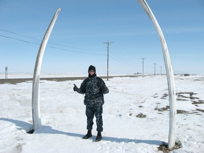 Andrew Stull, environmental health specialist for the Lawrence-Douglas County Health Department, stands between the bones of a Bowhead whale near a cemetery in Point Hope, Alaska.