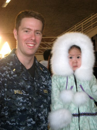 Andrew Stull, environmental health specialist for the Lawrence-Douglas County Health Department, is pictured with a little girl in Point Hope, Alaska.