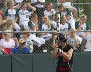 Lawrence High junior Andrea Mills concentrates as she steps to the plate while Free State players watch from the stands in the background during Lawrence High's first round 2013 state softball regional game against Olathe Northwest, Wednesday at Free State. The Lions fell to the Ravens and ended their season with the loss.