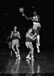 In this file photo from Dec. 5, 1955, Kansas University freshman Wilt Chamberlain (23) scores a goal during a freshman intrasquad game. At left is freshman Monte Johnson (6).