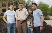 Salam Al Ghafli and his mother Fatimah will both graduate from KU on Sunday with bachelor's degrees. Salam and Fatimah took six classes together, and at Fatimah's insistence, sat side by side in the front row. Gathered Thursday in front of Strong Hall from left are Salam's brother Hassan Al Ghafli, his father Mansour Al Ghafli, his mother Fatimah Al Ghafli and Salam.