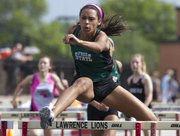 Free State junior Alexa Harmon-Thomas competes in the prelim round of the girls 100m hurdles at the Kansas class 6A state regional track meet Friday at Lawrence High.