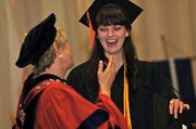 Baker University President Pat Long, left, shares a laugh with Class of 2013 graduate Sydney Doster after giving Doster her diploma. Doster will leave in mid-July to teach English in Nepal courtesy of a Fulbright Scholarship.