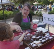 Janice Nesler-Loux serves up her bacon-laced fudge at the Lawrence Farmers Market.