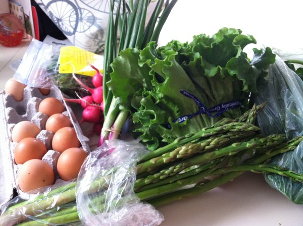 Asparagus, salad greens, spinach, eggs, radishes, green onions and head lettuce.
