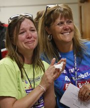 Hillcrest School first grader teacher Jenny Wilk, left, and fifth-grade teacher Denise Johnson show their excitement for McAdoo after it was announced that he was the recipient of the 2013 Bob's Award. Nick Krug/Journal-World Photo