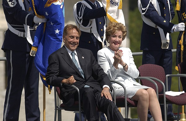 Former Sen. Bob Dole, his wife Sen. Elizabeth Dole, observe events during the dedication of the Dole Institute at Kansas University, July 22, 2003.