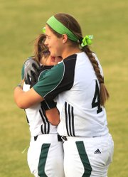 Free State third baseman Emily Byers (45) hugs teammate Emily Bermel after the Firebirds lost to Derby, 3-2 in eight innings, in the first round of the Class 6A state softball tournament, Thursday, May 23, 2013, in Overland Park.