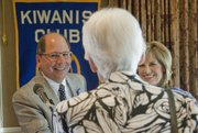 Gene Meyer, president and chief executive officer of Lawrence Memorial Hospital, left, and his wife, Carol, right, visit with Julie Hack on Thursday at the Lawrence Country Club. Meyer was presented with the 2013 Kiwanis Substantial Citizen Award at the Lawrence Kiwanis Club luncheon.
