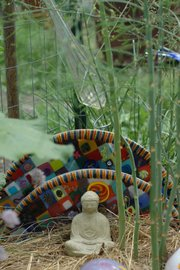 Bob Gent's backyard herb garden is dotted with sculptures, artwork — he's a glass artist — and, at one end, asparagus. The home of Gent and his wife, Kirsten Bosnak, at 18th and Barker streets is one of 18 stops on the 2013 Lawrence Food Garden Tour.