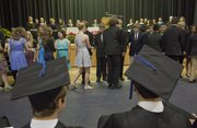 Richard Gwin/Journal World Photo. Bishop Seabury held its 2013 graduation ceremony on Friday May 24, 2013. Students from the lower grades shake hands with older students as part of a stepping up ceremonies during graduation.