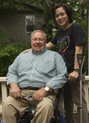 Yen Vo, right, stands next to her former Kansas University adviser, Professor Glen White. Vo, who graduated with a master's degree in 2004, has been a leader in advocating for rights of people with disabilities in Vietnam.