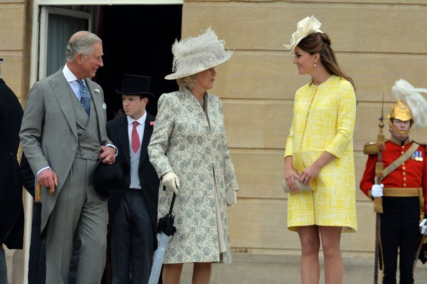 Britain's Prince Charles, left, Camilla Duchess of Cornwall, centre, and Kate Duchess of Cambridge attend a Garden Party hosted by Queen Elizabeth II in the grounds of Buckingham Palace, central London Wednesday May 22, 2013. (AP Photo/ John Stillwell/PA)