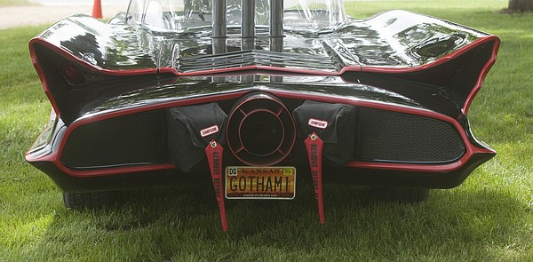 "The finished car, right photo, bears a ""Gotham"" license tag, after the famous fictional city."