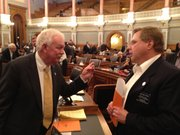 House Speaker Ray Merrick, R-Stilwell, (left) speaks with state Rep. Mark Hutton, R-Wichita, after a tax increase proposal by Hutton and state Rep. Gene Suellentrop, R-Wichita, was defeated on Thursday. Merrick voted against the plan.