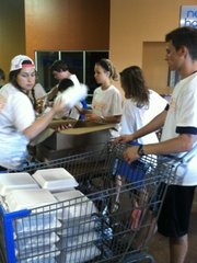 Douglas County Young Life volunteers help at a makeshift grocery near the tornado-devastated town of Moore, Okla., this week.