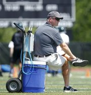 Free State football coach Bob Lisher watches over drill stations during Free State camp on Monday, June 3, 2013.