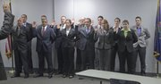 Police recruits are sworn in Tuesday by the Lawrence Police Department at the Investigations and Training Center. Back row, from left: John Pien, Ryan Douglas, Jonathan Gardner, David Nigro, Nicholas Simon, Narissa Dunn, Meagan Shipley. Front row, from left: Shawn Daubert, Skyler Richardson, Lindsay Bishop, Cody Williamson, Kristen Kennedy, Myra Gillum.